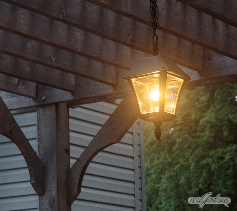 You don't need to spend a fortune or hire a professional to install outdoor landscape lighting. Learn how to install an outdoor solar chandelier pendant light in your pergola, gazebo or porch in less than an hour. No electrician or wiring required! #ad #solarlights #outdoor lights #pergolalights
