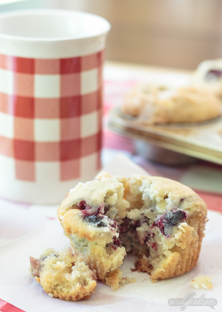 This delightfully delicious white chocolate cherry muffin recipe is made with fresh fruit and white chocolate chips. They're delicious with coffee for breakfast, but they're sweet enough for dessert, as well. #whitechocolate #cherries #muffins #breakfastrecipes #cherrymuffins #dessertforbreakfast