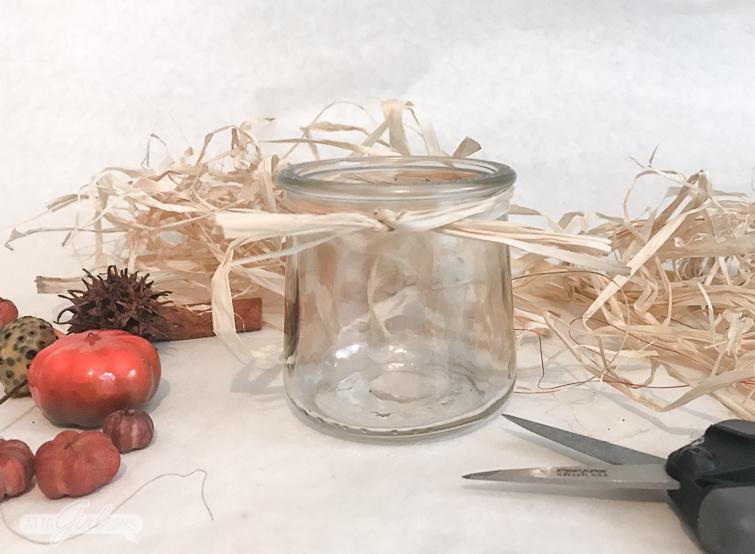 glass yogurt jar with raffia tied around the neck