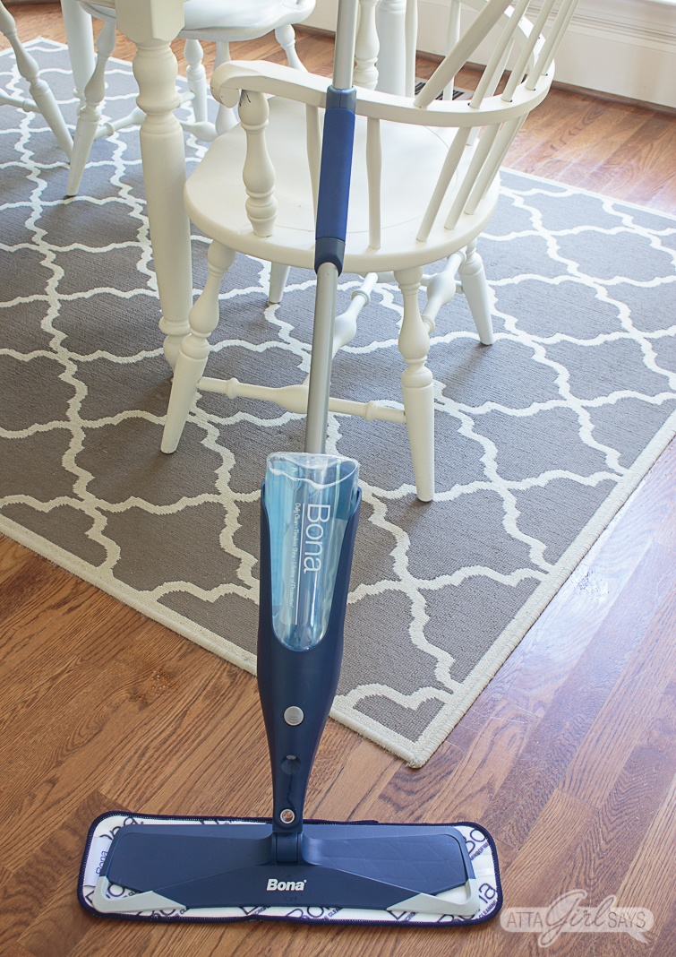 Bona Spray Mop leaning against a white kitchen chair