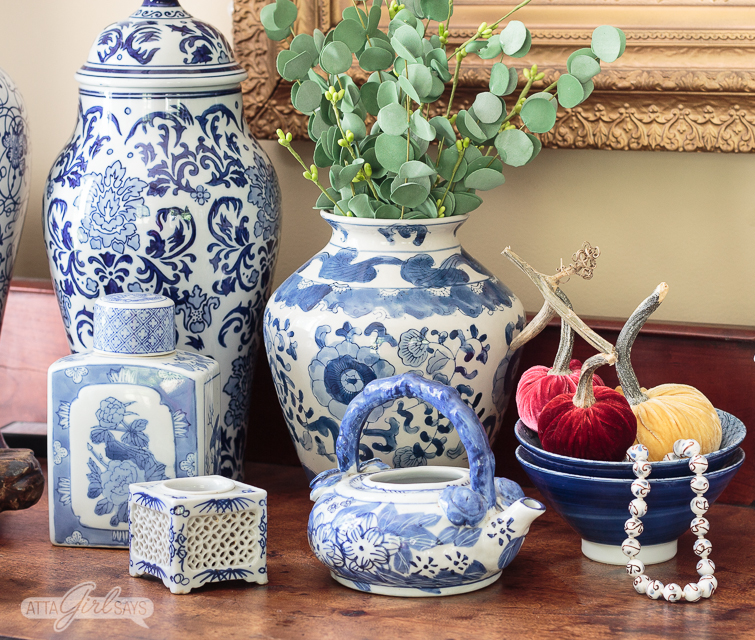 blue and white lamps and ginger jars on a sideboard