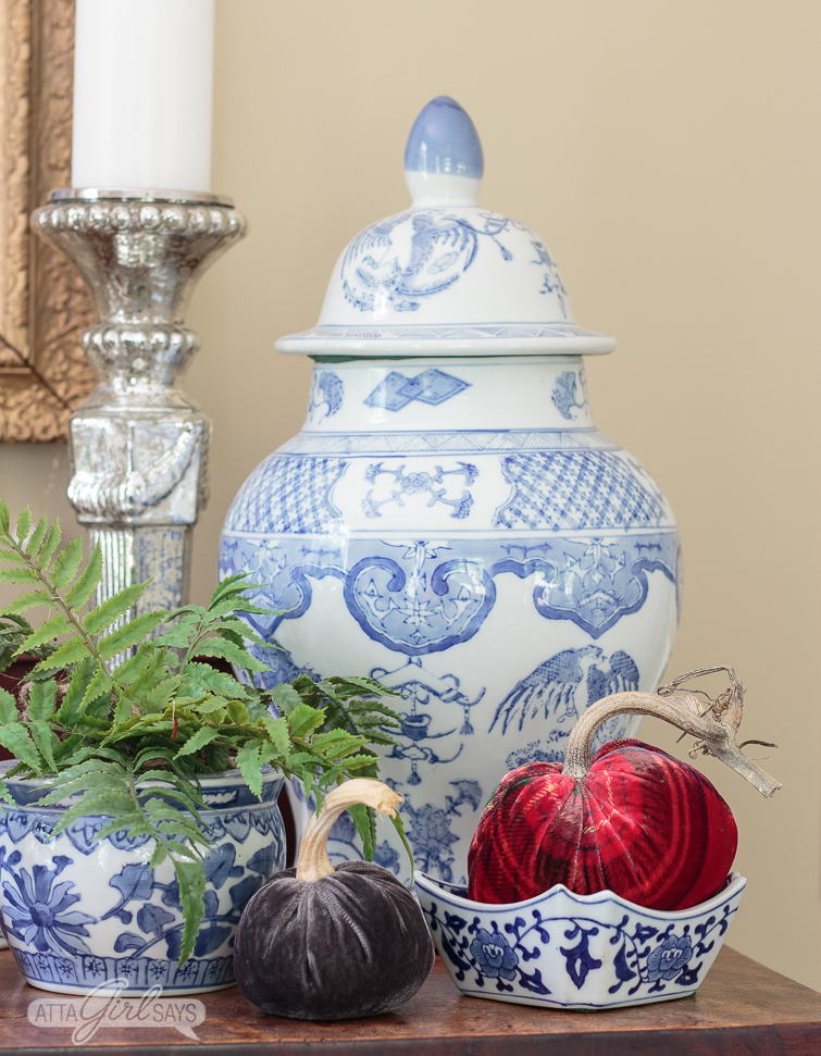 blue and white ginger jar, flower pot and cachepot on an antique empire sideboard decorated for fall