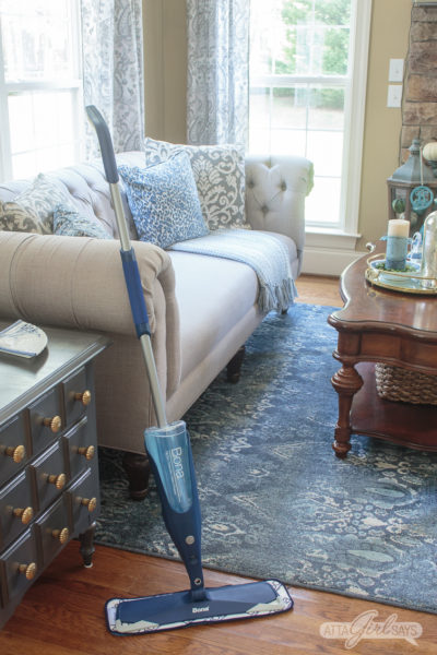 closeup photo of a Bona spray mop cleaning oak hardwood floors