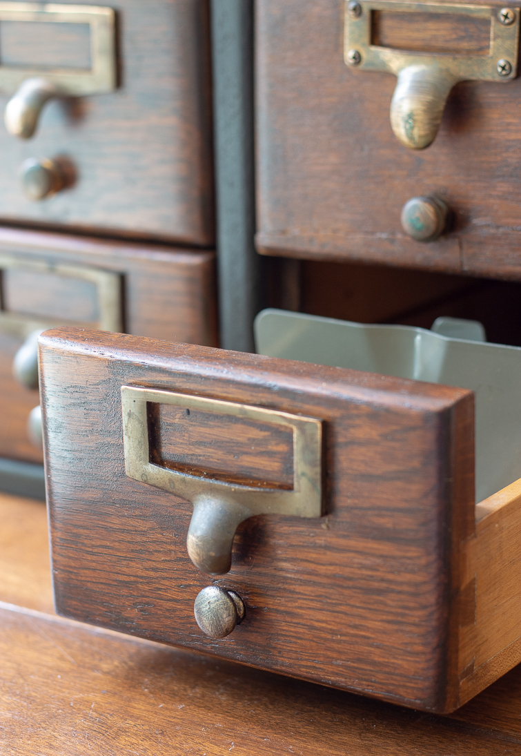 closeup of a wooden card catalog drawer