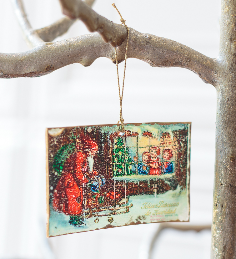 vintage postcard Shrinky Dinks Christmas ornament hanging from a silver tree