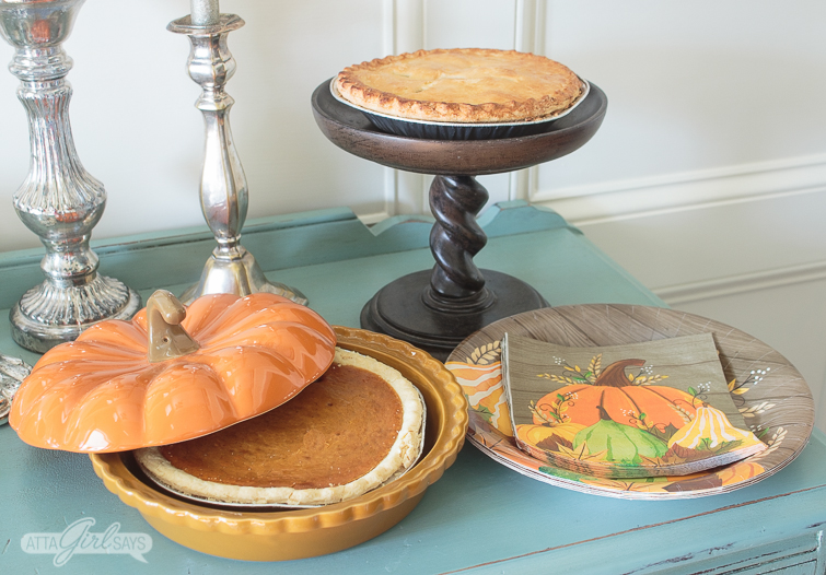pumpkin pie and apple pie for Thanksgiving on a sideboard