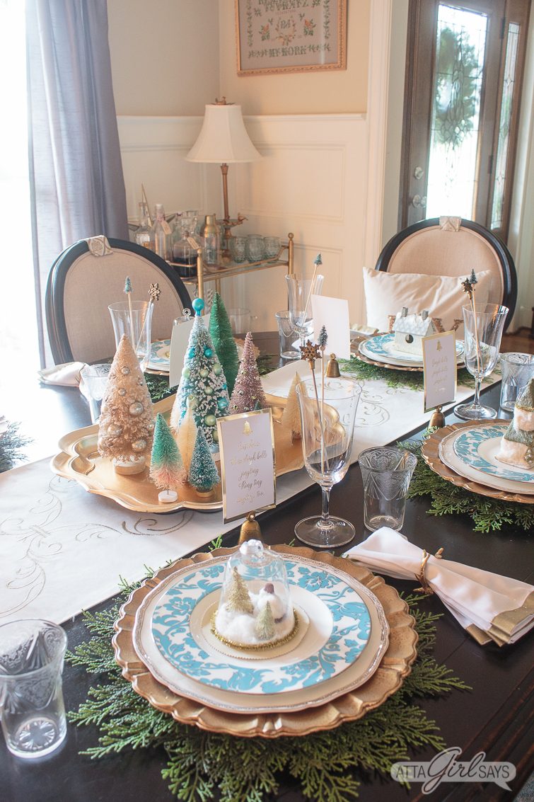 dining room Christmas table decorations with gold accents, aqua china and bottlebrush Christmas trees