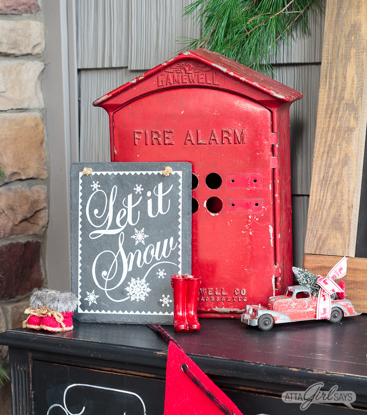 vintage red fire alarm box used on a front porch as Christmas decor