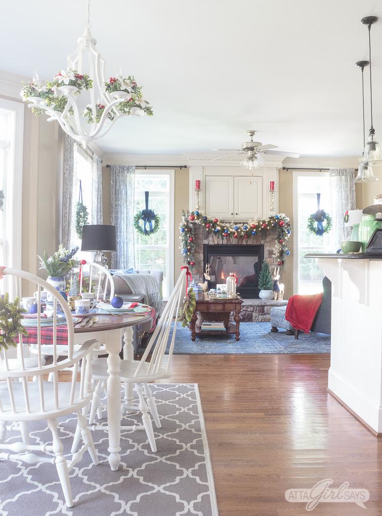 open concept family room and kitchen decorated in bleu and red for Christmas