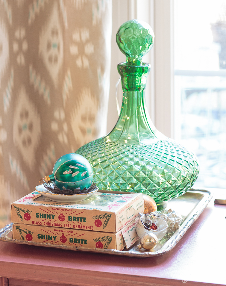 Shiny Brite ornament boxes and a green glass decanter