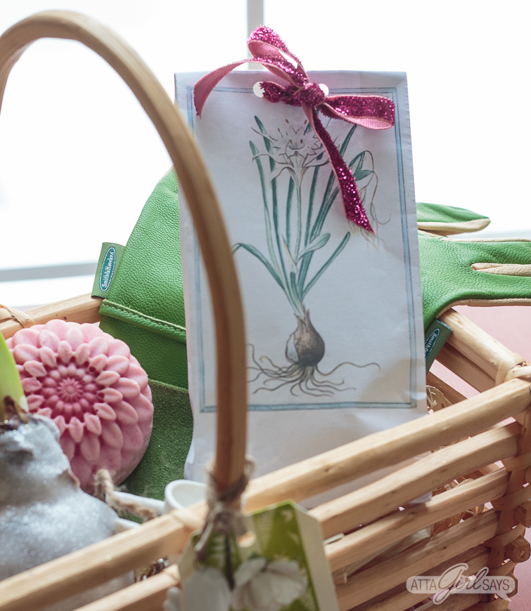 garden-themed hostess gift filled with waxed amaryllis bulbs, homemade lotion bar, gardeners hand salve, paperwhite bulbs and gardening gloves