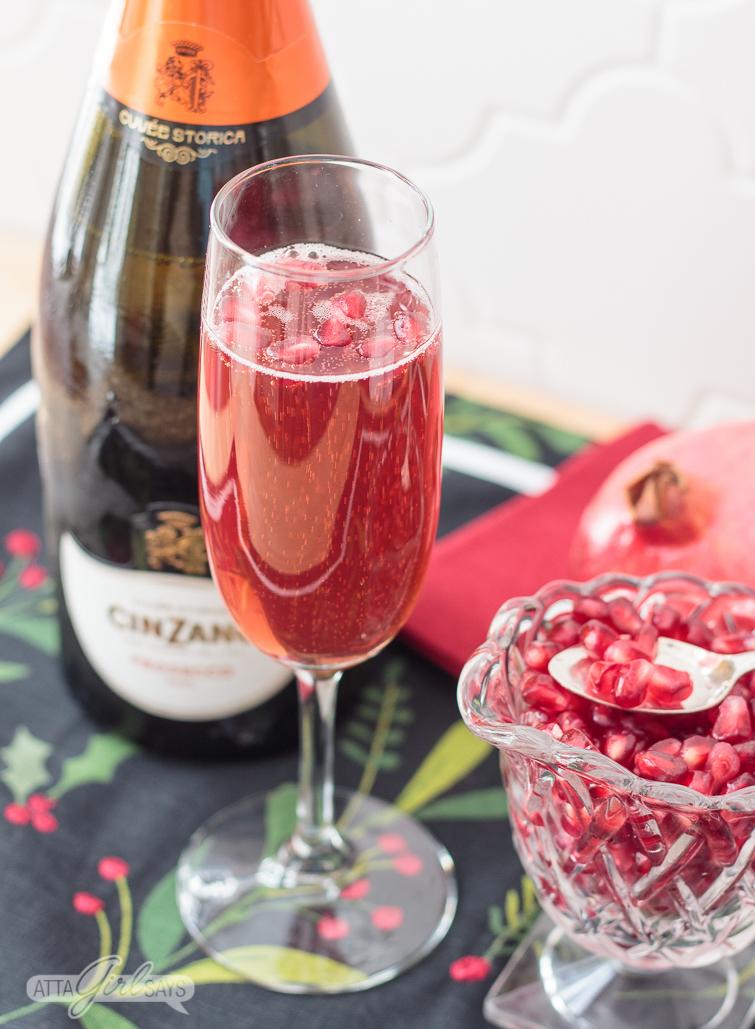 festive pomegranate mimosa made with prosecco