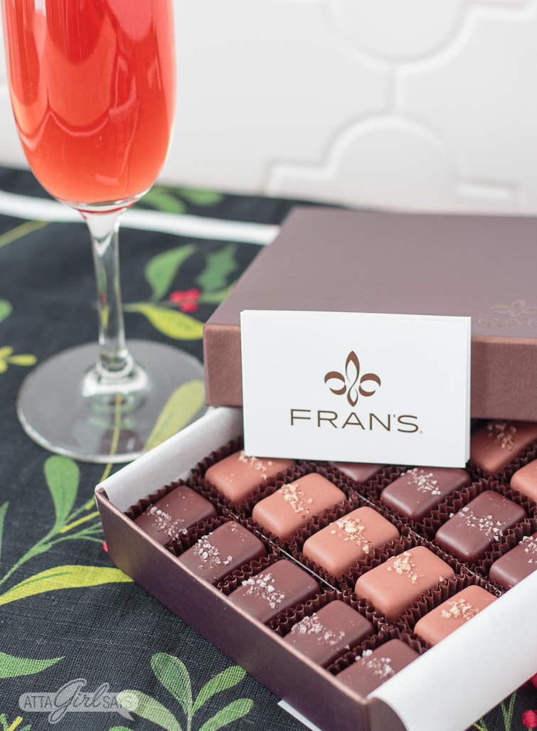 pomegranate mimosa and a box of chocolate salted caramels