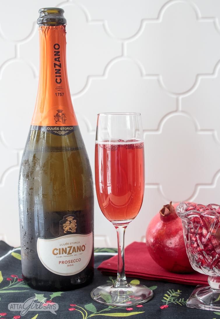 pomegranate mimosa and a bottle of Cinzano prosecco