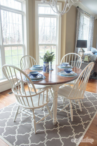 farmhouse style stained kitchen table with white legs and painted Windsor dining chairs