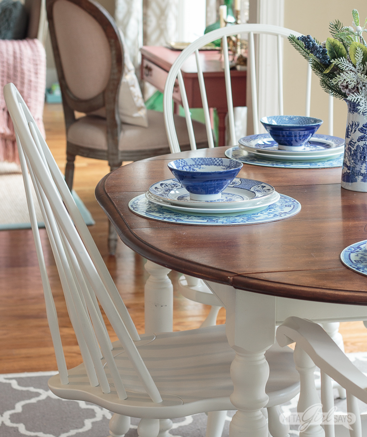 painted white windsor dining chair at a farmhouse stained dining table