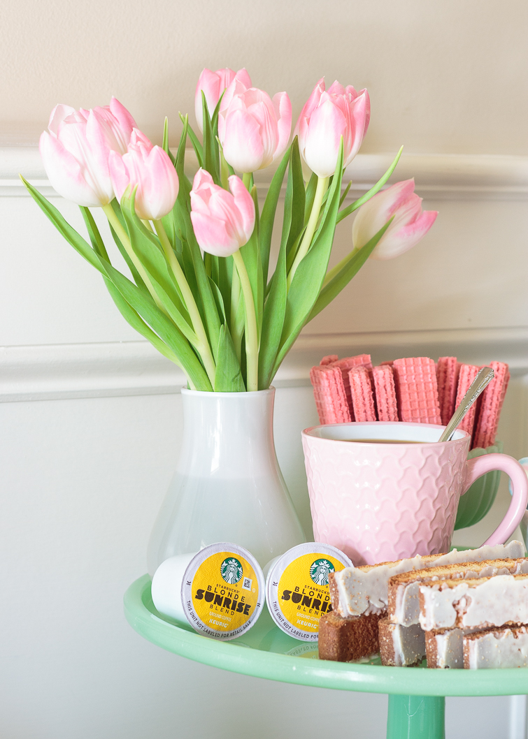 bouquet of pink tulips on a green cake stand with coffee bar fixings