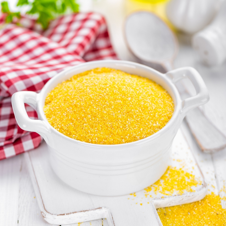 yellow stone ground grits in a white bowl