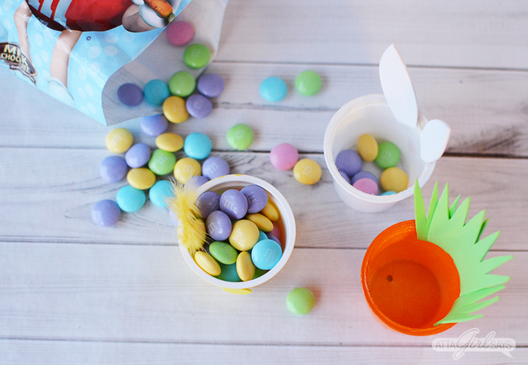filling recycled K cups with Easter M&Ms candies