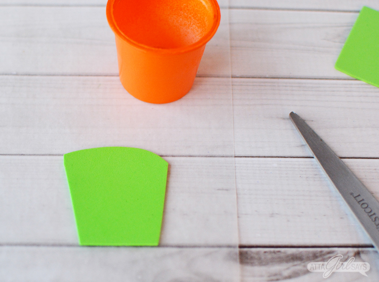 Use green foam to make grass for carrot Easter treat cups
