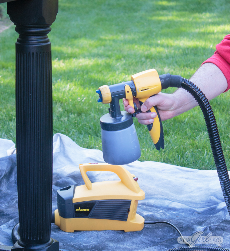 using a Wagner FLEXiO 4000 sprayer to paint an outdoor sink