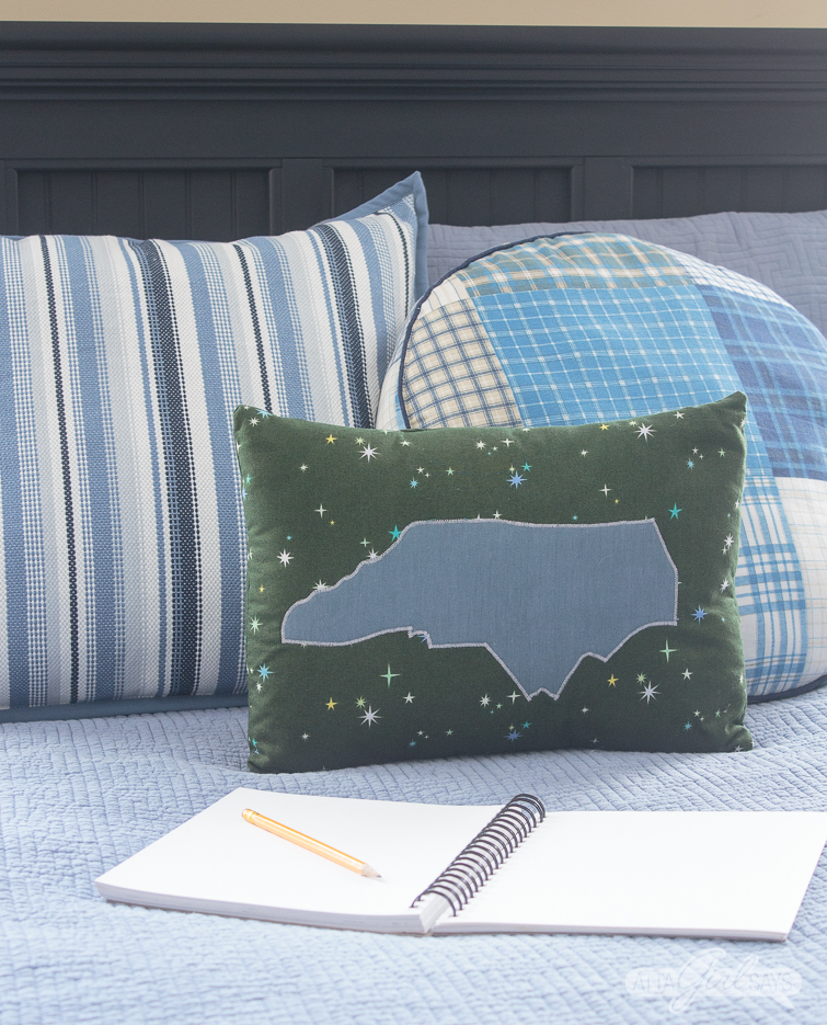 North Carolina pillow and sketch pad on a tween boy's bed