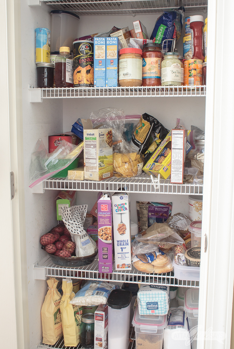 messy pantry with wire shelving