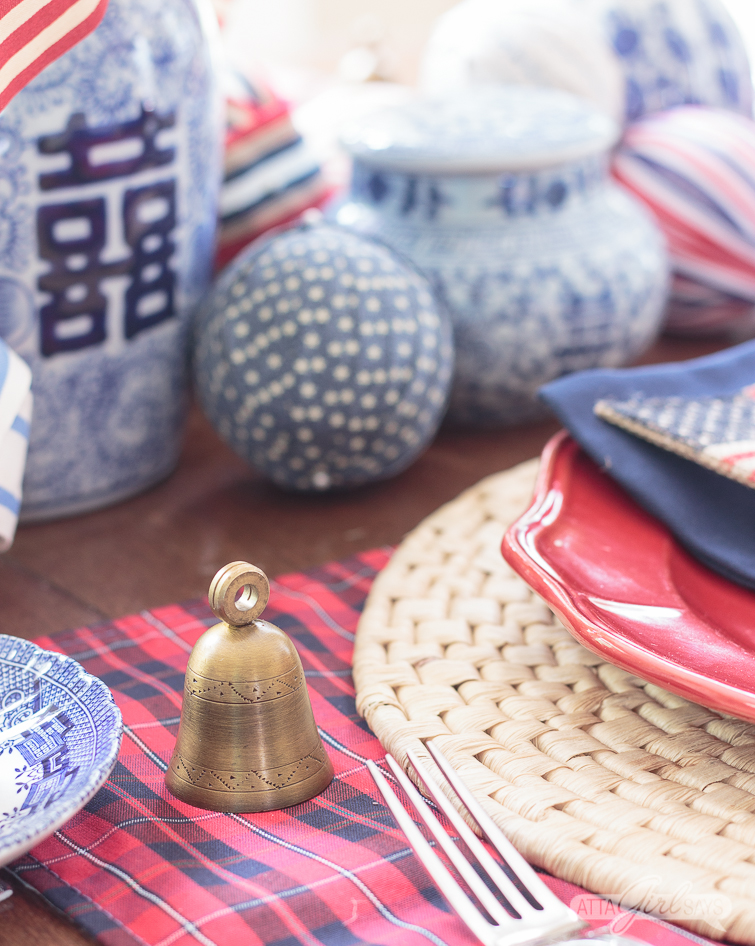 brass bell place card holder on a patriotic table