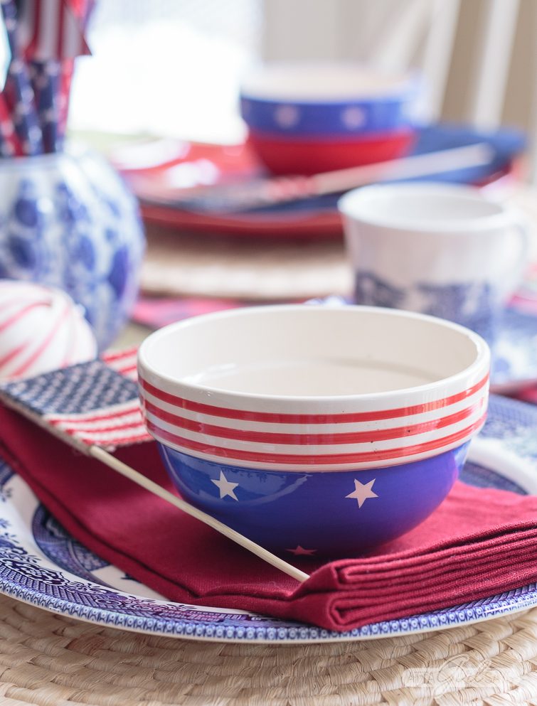 patriotic tablescape with blue and white china and ginger jars mixed with plaid
