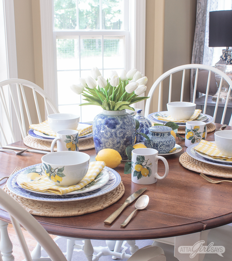 table set with Blue Willow china and Dollar Tree lemon plates