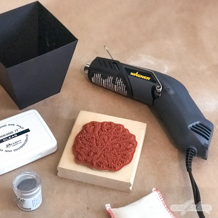 embossing heat gun, rubber stamps, embossing powder, metal cachepot and other supplies for embossing