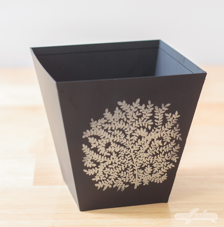 black metal cachepot with an embossed silver tree design