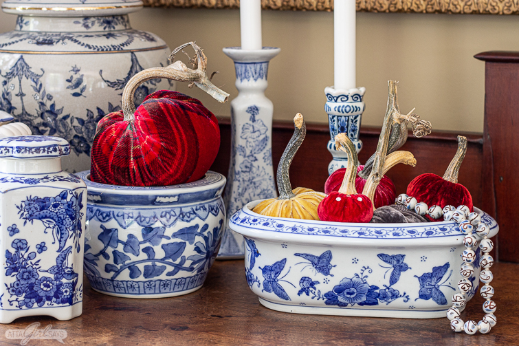 velvet pumpkins in blue and white chinoiserie on an antique empire sideboard