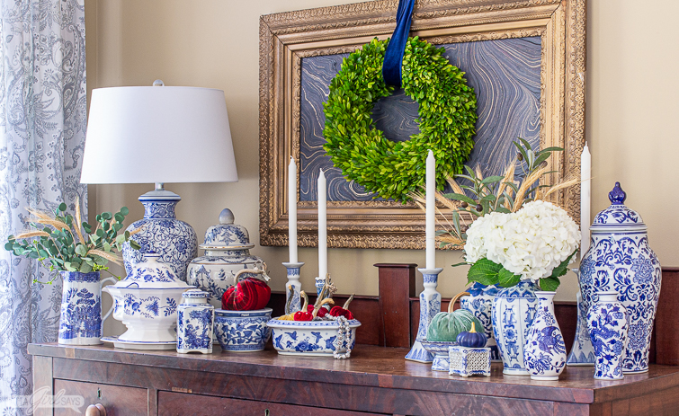 sideboard decorated with blue and white porcelain and velvet pumpkins for fall