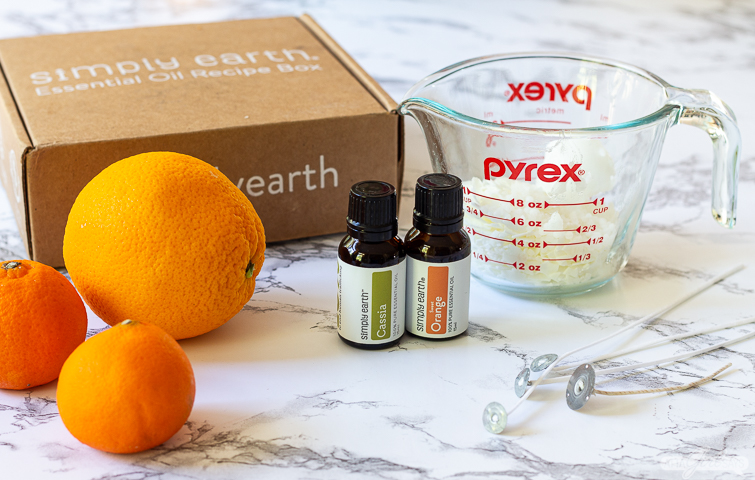 oranges, essential oils and soy wax from the Simply Earth box to make orange candles
