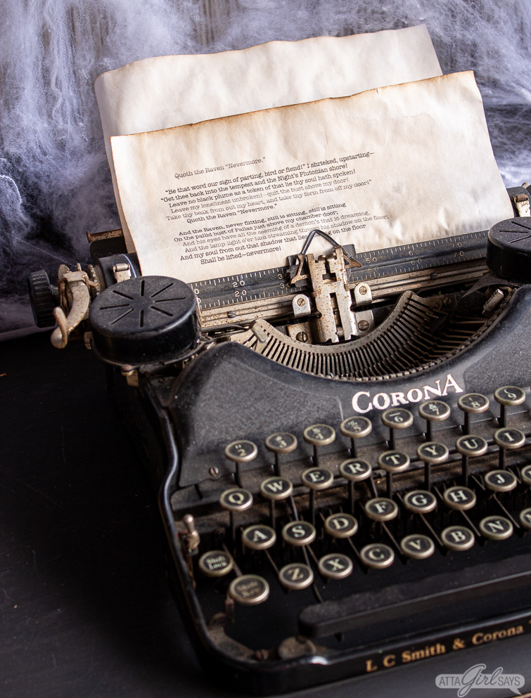 old Corona typewriter with stained parchment paper in it for Halloween