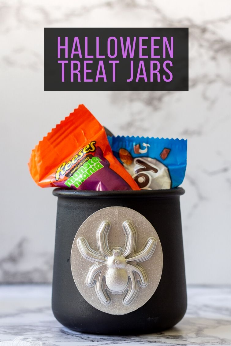 Black Halloween treat jar with a silver resin spider medallion on it