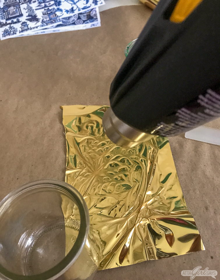 using a heat gun to apply reactive foil to patterned paper