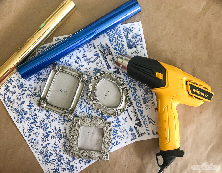 metallic foil, blue and white chinoiserie printouts, small frames and heat gun to make chinoiserie Christmas ornaments