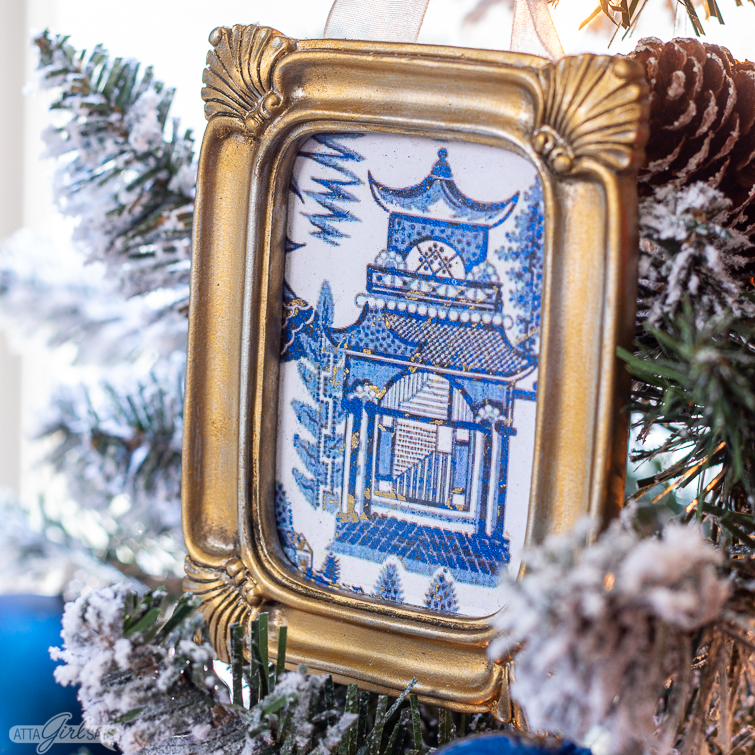 Chinese pagoda chinoiserie Christmas ornament hanging on a Christmas tree