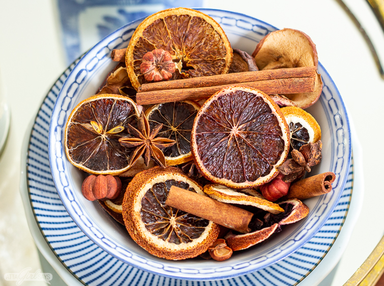 dried oranges and cinnamon stick Christmas potpourri in a blue and white bowl