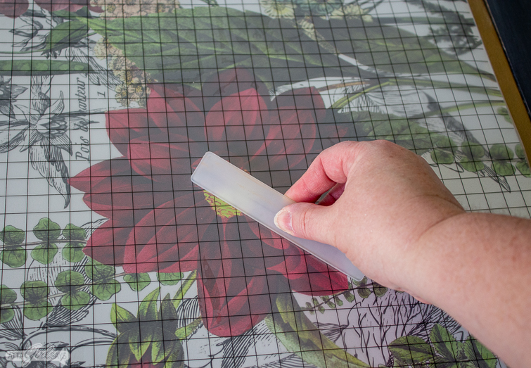 applying a decorative rub-on transfer to a folding game table