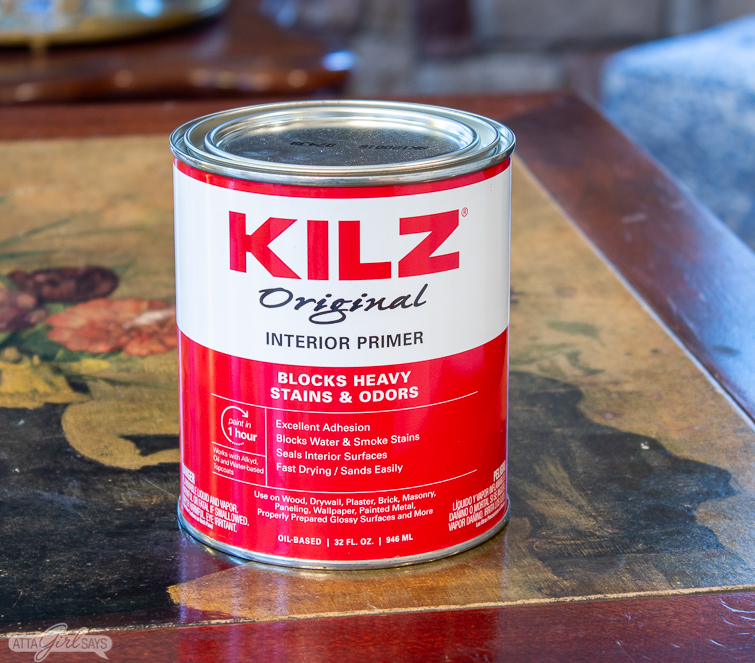 can of KILZ primer on a floral tabletop