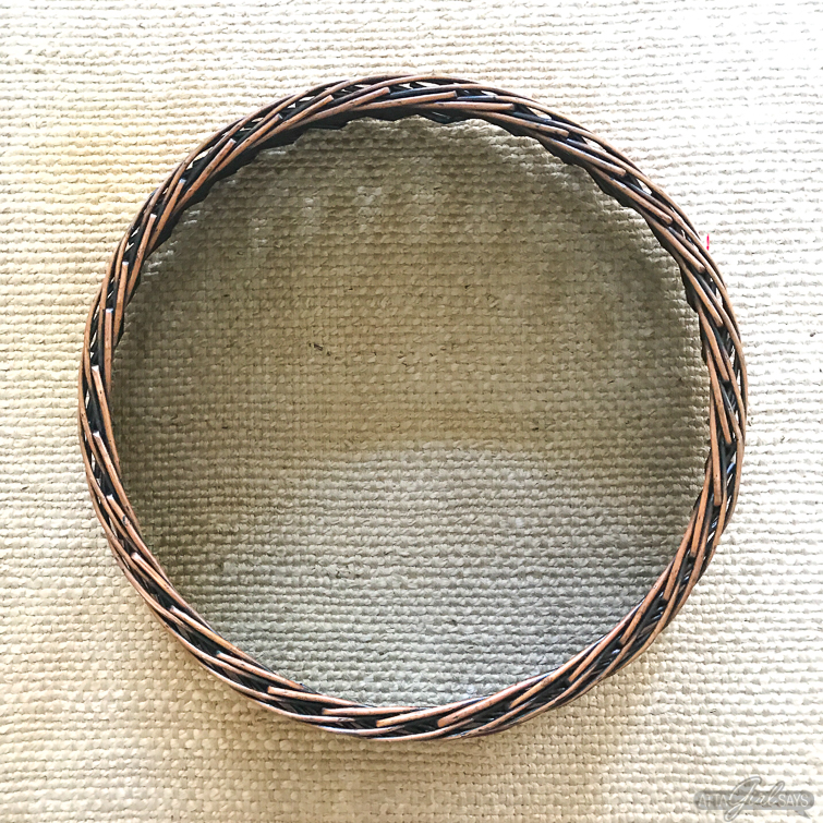 overhead view of a rattan Christmas tree collar on a seagrass rug