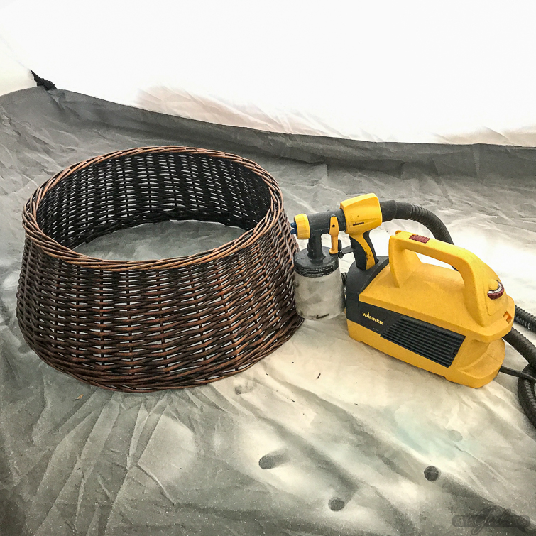 rattan Christmas tree collar in a spray tent with a Wagner paint sprayer
