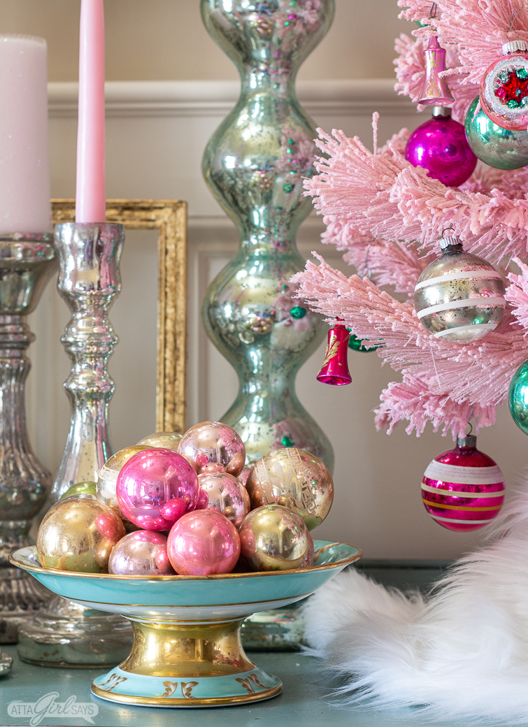 aqua and gold compote filled with pink and gold glass Christmas ornaments