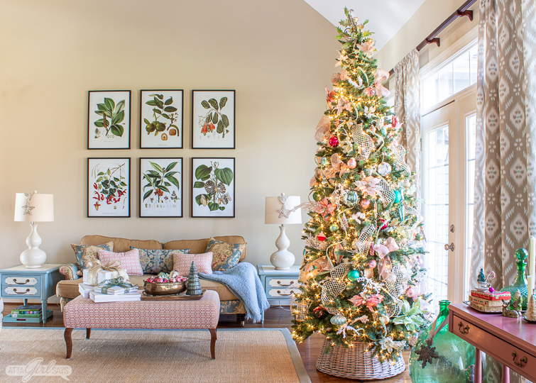 beautiful Christmas tree decorated with pink and green ornaments in a formal living room