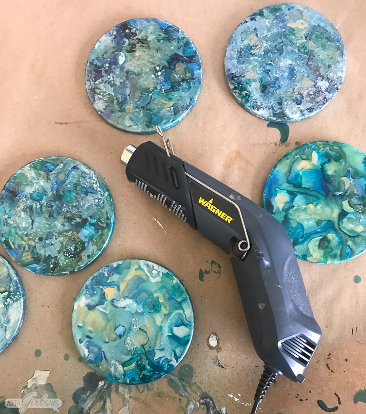 marbleized alcohol ink coasters and a craft heat gun