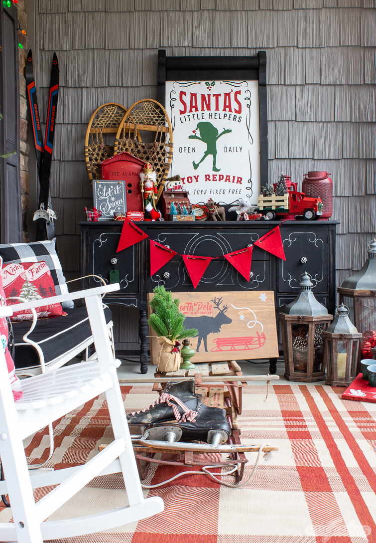 vintage style Santa's workshop sign on a Christmas front porch