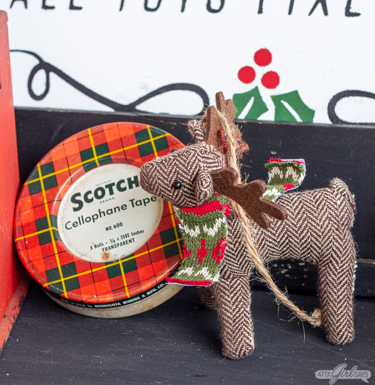 stuffed tweed reindeer and a vintage plaid scotch tape tin